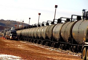 Trucks loading oil to tanker cars in North Dakota
