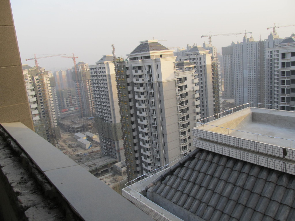 Circle of Blue's Choke Point: China project showed how China's massive energy-consuming urban construction program, like this development in Xian, is producing an urgent confrontation over water in the dry north, where much of China's energy is produced. Photo/Keith Schneider