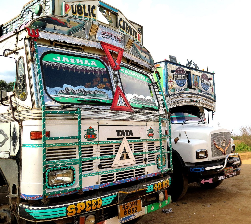The police in West Jaintia Hills are episodically enforcing a court-ordered ban on mining and transport of coal in Meghalaya, a Northeast India state. Police have arrested over 30 truck drivers, dumped their loads in a field owned by the district, and seized a number of trucks, including these two. Photo/Keith Schneider