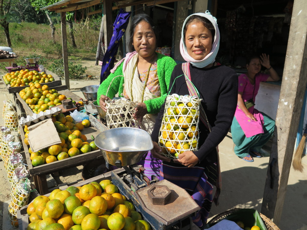 Orange producers sell fruit in baskets woven from bamboo in Arunachal Pradesh. Photo/Keith Schneider