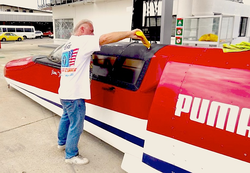 "Jim ""Jet"" Neilson with one of the rocket cars he stores in Panama. He's struggling with Panama officials to stage an event to run another of his jet cars in Panama City."