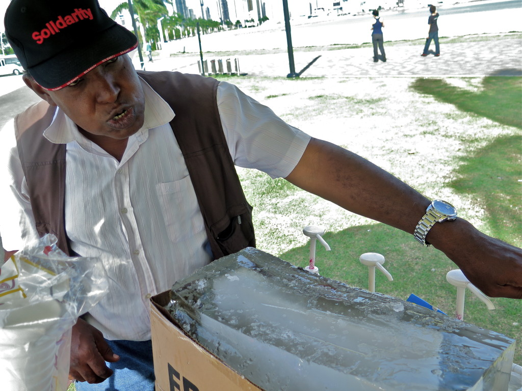 A vendor along the Avenida Balboa shaves ice for snow cones in Panama City. Photo/Keith Schneider