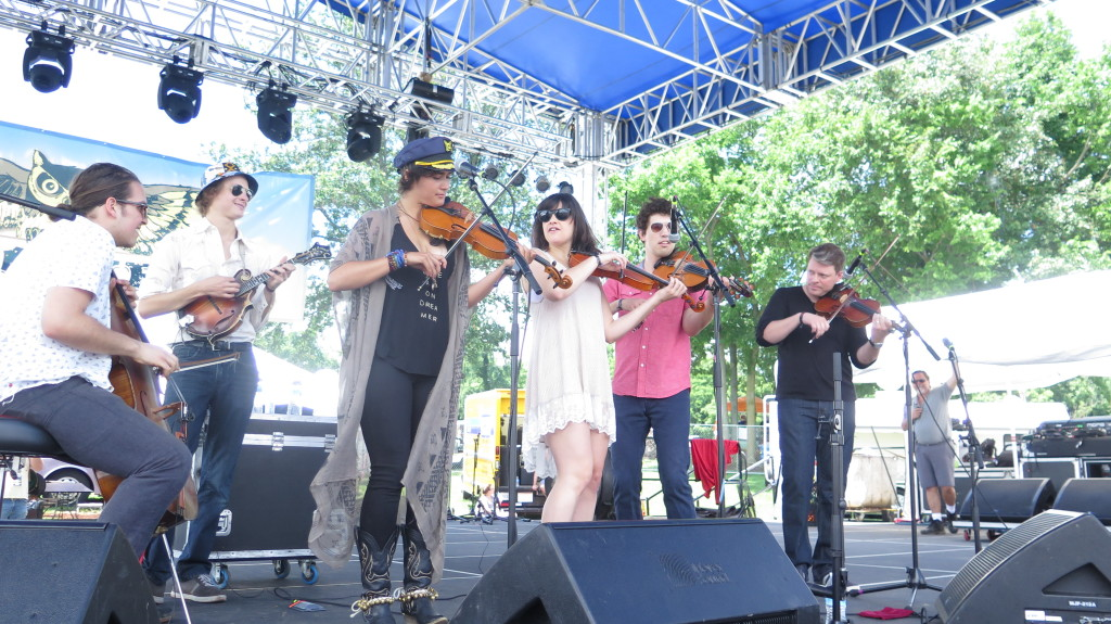 Phoebe Hunt (hat and fiddle) performs center stage at the 2015 ROMP fest with (l to r) Nathaniel Smith (cello), Dominick Leslie (mandolin), Rachel Baiman (fiddle), Christian Sedelmyer (fiddle), and Luke Bulla (fiddle). Photo: Keith Schneider