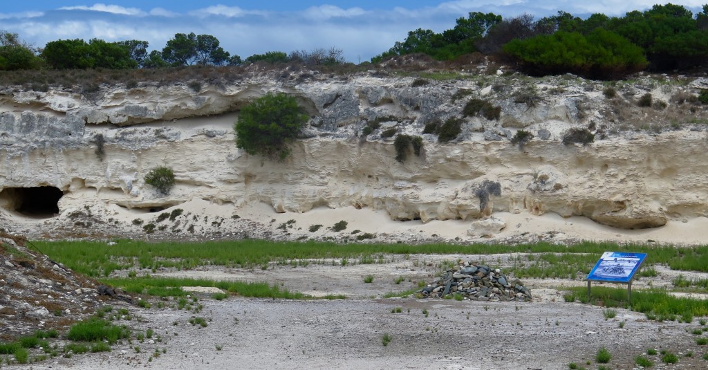 Quarry where Nelson Mandela spent years pounding rocks. The stone pile in front was started by Mandela during a 1995 reunion attended by 1,300 released prisoners. Each dropped a stone in memory of their time and struggle for national freedom. Photo/Keith Schneider