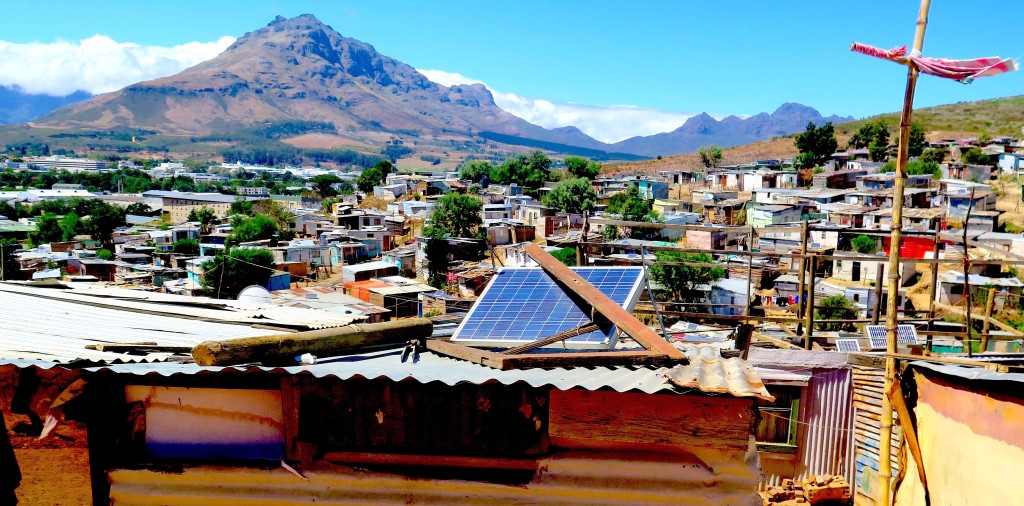 Photo voltaic panels supply electricity to homes in  an informal settlement in Stellenbosch, South Africa. Photo/Keith Schneider