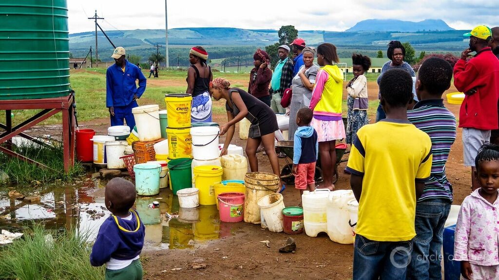 Paulpietersburg residents filling water buckets during deep season of drought. Photo/Keith Schneider